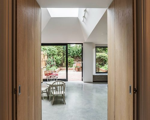 Interior views with wooden and marble floors leading to garden