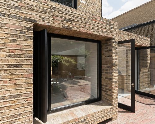 Exterior of the contemporary extension with London brick and large modern windows