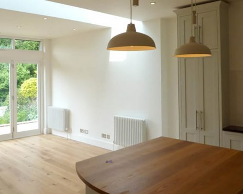 Kitchen and downstairs room with natural and electric lighting