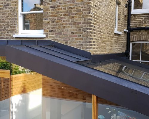 Glass and zinc roof of extension to London terrace home
